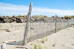 Beach fence in sand. Wooden beach fence in sand near rock jetty at Cape Disappointment, Washington Royalty Free Stock Photos