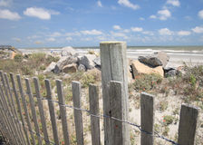 Beach Fence. Fence at the shore line Stock Photography