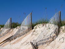 Beach fences and sand dunes. Row of 3 beach fences on a sand dune Royalty Free Stock Image
