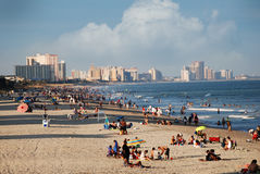 Beach filled with people in Myrtle Beach, South Carolina. Beach filled with people on s summer day with the coastline of buildings in the background in Myrtle stock photo