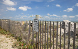Beach Fine. Beach fence fine sign at the shore Stock Image