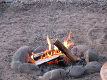 Beach Fire. In the sand surrounded with a ring of stones Royalty Free Stock Image