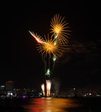 Beach fireworks with city night view Royalty Free Stock Photo