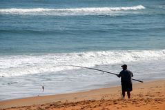 Beach fisherman Royalty Free Stock Photo