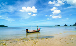 Beach and a fishing boat Stock Image