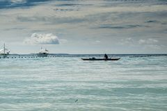 The beach with a fishing boat royalty free stock photography
