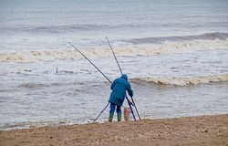 Beach fishing in winter. Stock Images