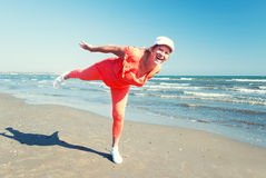 Beach fitness. Mature woman enjoying her fitness exercises  on a beach Royalty Free Stock Photo