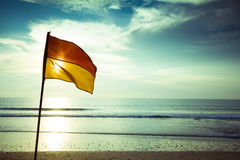 Beach with flag. Exotic beach with flag in Bali, Indonesia Royalty Free Stock Image