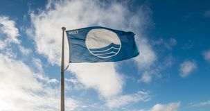 Beach Flag at ISLE OF ANGLESEY, GWYNEDD, NORTH WALES -. Porth Dafarch beach at ISLE OF ANGLESEY, GWYNEDD, NORTH WALES Stock Photo