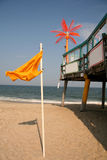 Beach Flag next to Pier Stock Photography