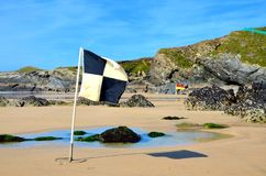Beach flags, Lusty Glaze beach, Newquay in Cornwall. Beach Flags at Lusty Glaze Beach, Newquay, Cornwall royalty free stock images