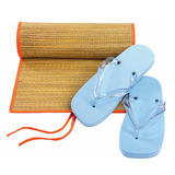 Beach flip-flop matting. Flip-flop and matting on the beach Royalty Free Stock Photography