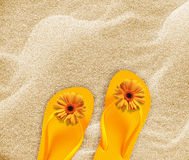Beach flip flops. A pair of flip flops on the beach sand, Summer back concept stock photos
