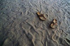 Beach Flip Flops. Flip flops in the sand at a beach Stock Photography