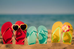 Beach flip-flops on the sand Royalty Free Stock Photos