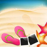 Beach. With flip-flops, seastar and  photoframe Royalty Free Stock Photography