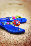Beach flip flops on tropical sandy coast. Holiday concept Royalty Free Stock Photography