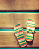Beach flip flops on wood. Summer vacations background Royalty Free Stock Images