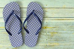 beach flip flops on wooden floor stock photos