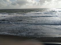 Beach in florida waves and seafoam beautiful landscape. royalty free stock photography
