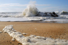 Beach with foaming waves Royalty Free Stock Image