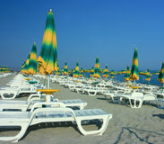 Beach with folded umbrellas Stock Photography