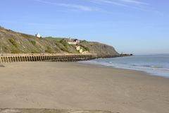 Beach by Folkestone harbour. Kent. England. Sandy beach by the harbour at Folkestone in Kent. England Stock Images
