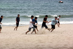 A beach football match Stock Images
