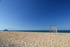 Beach football pitch on a sunny day, popular sport on the beach Royalty Free Stock Images