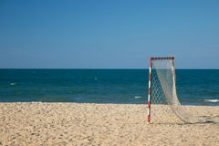Beach football pitch on a sunny day, popular sport on the beach Stock Images
