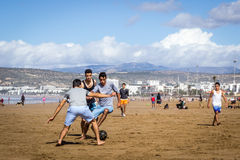 Beach Football. Young men playing football on the beaches of West Morocco Royalty Free Stock Photo