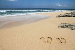 Beach with Footsteps and Stones-Bali,Indonesia Royalty Free Stock Photo