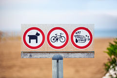 Beach forbidden sign for dogs bikes and music Royalty Free Stock Photo