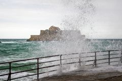 The beach and Fort National during high tide in Saint Malo. Bretagne, France on a stormy, cloudy day in summer royalty free stock images