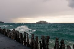 The beach and Fort National during high tide in Saint Malo. Bretagne, France on a stormy, cloudy day in summer stock photo