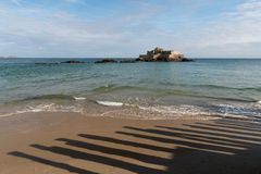 The beach and Fort National during high tide in Saint Malo. Bretagne, France on a sunny day in summer stock photo