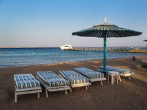 Beach with Four Chairs and Umbrella Stock Photos