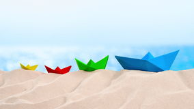 On the Beach - Four colorful paper boats on a sand dune in front of beautiful azure sea on a sunny day  - seamless loop - ProRes stock video