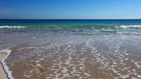 Beach with fresh footprints washed away stock footage
