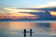 Beach Friends. Friends taking in the sunset at a resort on Ko Pha-Ngan island in Thailand Royalty Free Stock Images