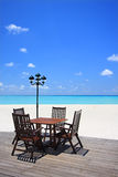 Beach front. Chairs and table on beach patio Stock Photography