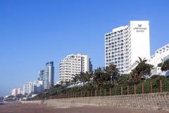 Beach Front City Skyline Against Blue Sky Stock Photography