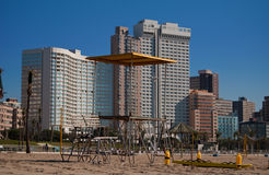 Beach front, Durban, South Africa. Life guards' platform on North Beach, Durban, South Africa, with hotels and holiday apartments in the background Royalty Free Stock Photos