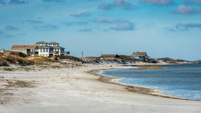 Beach Front Houses at the coast royalty free stock photography
