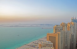 Beach Front Living. Luxury high rise towers overlooking the famous Palm Jumeirah in Dubai royalty free stock photo