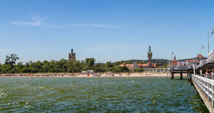 Beach in front of old lighthouse, Sopot. SOPOT, POLAND - JUNI 6: Beach on the coast of the Baltic Sea in front of old lighthouse in Sopot, Poland on Juni 6, 2015 Royalty Free Stock Image