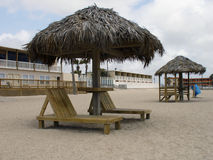 Beach front resort. A pair of chairs on the beach in front of a resort Royalty Free Stock Photo