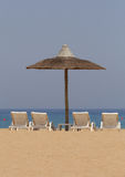 Beach in Fujairah. Sunshade tent and chairs on beach in Fujairah, UAE Stock Images
