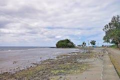 A beach full of stones and rocks around Ovalau island, Fiji Stock Photo
